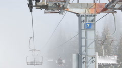 Chairs of a ski lift into the fog of a foggy Vitosha mountain weather Stock Footage