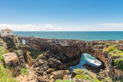 The Hell's Mouth chasm located in Cascais. - stock photo