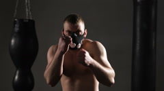Intimidating shadow boxing. Young athlete trains in the boxing hall Stock Footage