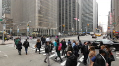 Crowd of people walking crossing street jib crane shot in New York City Stock Footage