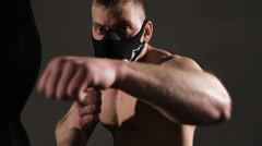 Terrible young man in a mask. Aggressive beats ahead - stock footage