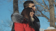 Couple in love cuddling in a park - stock footage