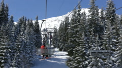 Ski lift in the snowy mountain Stock Footage