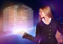 Business woman holding a wireframe house on the hand - stock photo