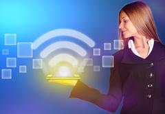 Business woman holding an icon wi-fi with a bright glow Stock Photos