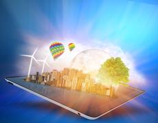 Ecological city with clouds and windmills on the tablet Stock Illustration