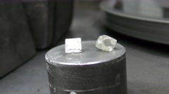 A rough diamond and a polished diamond Stock Footage