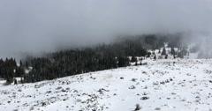 4k tilt timelapse of Vitosha mountain in snow and mist Stock Footage