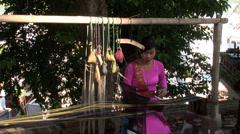 Young Vietnamese woman weaving - stock footage