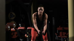 Endurance. Muscular woman exercising with rope in crossfit gym Stock Footage