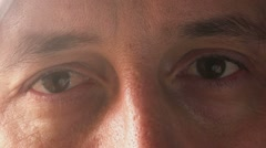 Close up footage of sad adult male eyes Stock Footage