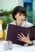 woman cafe reading menu - stock photo