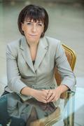 Stock Photo of Beautiful businesswoman in bright suit