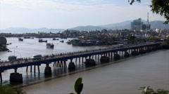 Motor cycles crossing the Tran Phu Bridge Stock Footage