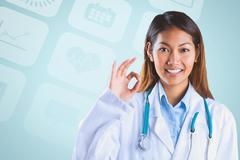 Composite image of asian doctor doing ok sign - stock photo