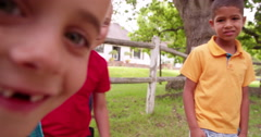 Little children being silly with friends and smiling into the camera - stock footage