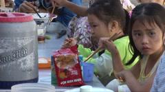 Vietnamese children eating noodles Stock Footage