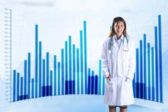 Composite image of asian doctor with stethoscope looking at camera - stock photo