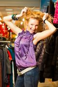 Beautiful woman in clothing store Stock Photos