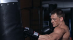 Handsome fit man boxing. Slow motion Stock Footage