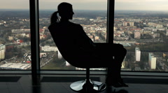 Silhouette of happy businesswoman touring round on the armchair in the office Stock Footage