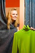 Beautiful woman in clothing store - stock photo