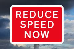 British signpost REDUCE SPEED NOW Stock Illustration