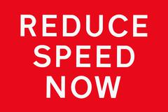 Red white REDUCE SPEED NOW Stock Illustration