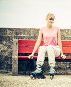 Woman with roller skates outdoor. - stock photo
