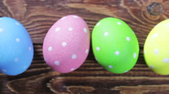 Easter eggs on wooden background - stock footage