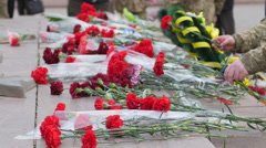 Laying flowers at the memorial to the victims of The Second World War - stock footage