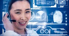 Composite image of smiling businesswoman using headset Stock Photos