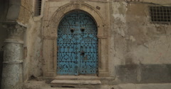Close Up Shot Of Garnished Old Blue Door in Tunis Stock Footage