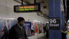 B train entering station 96th Street platform people waiting 4K NYC with audio Stock Footage