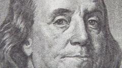 Stock Video Footage of macro of 100 dollar bill with Benjamin Franklin portrait