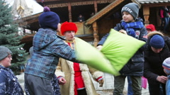 hilarious pillow fight on a holiday carnival Maslenitsa - stock footage