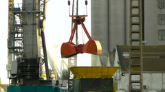 Crane Unloading and Loading at Harbor Stock Footage