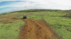 Off-road 4wd Land vehicle driving across dirt country road - stock footage