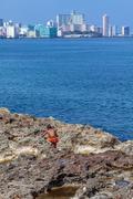 HAVANA, CUBA - APRIL 1, 2012: Native boy and modern district Vedado Stock Photos