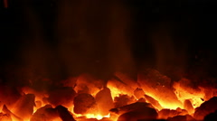 Fire of charcoal on black background - stock footage