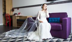 beautiful bride  with mobile phone. Concept of love and  interest. Newlywed - stock photo