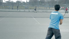 Amateur tennis match on public court (graded) Stock Footage