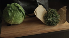 Getting vegetables and greens out of the bag and placing them on table - stock footage