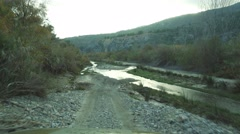 Offroad through a riverbed with a Jeep Wrangler, Andalusia, Spain Stock Footage