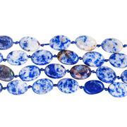 Strings of beads from blue lapis lazuli gem stones Stock Photos