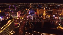 Caesars Palace, Planet Hollywood, and Paris Las Vegas 4k Aerial Night footage - stock footage