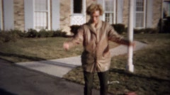 1963: Mother jumping rope attempt embarassingly fails quickly. Stock Footage