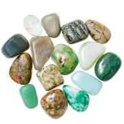 Pile of green natural mineral gemstones isolated Stock Photos