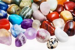 Many tumbled natural mineral gem stones Stock Photos