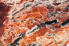 Texture of red brecciated jasper mineral gem stone Stock Photos